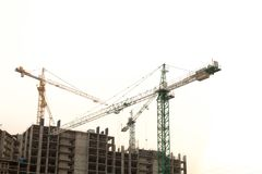 Construction site background. Hoisting cranes and new multi-storey buildings. Copy space for text. ndustrial background. Construction site background. Hoisting stock photography