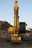 Construction site and backhoe Royalty Free Stock Photo