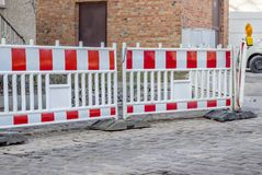 Red and white construction barrier. Construction site with barrier at a road Stock Photo