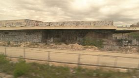 Construction site behind train window. Building companies expand the town stock footage