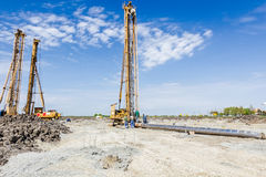 Construction site with big equipment for drilling into the groun Royalty Free Stock Images