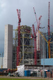 Construction site with big red crane. Construction of a new electric power plant Stock Images