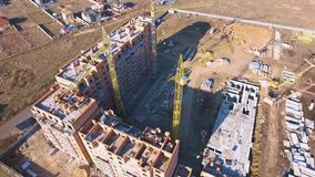Construction site with a bird`s eye. Shooting with drone. Building in the field.