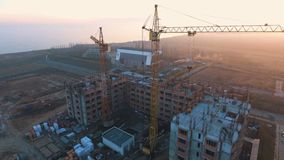 Construction site with a bird`s eye. Shooting with drone. Building in the field. stock video footage