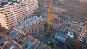 Construction site with a bird`s eye. Shooting with drone. Building in the field. stock video
