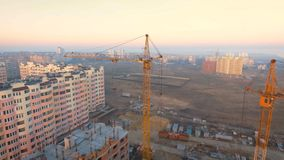 Construction site with a bird`s eye. Shooting with drone. Building in the field. stock footage