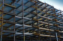 Construction site in blue. Construction site with partly with partly assembled steel structure royalty free stock photography