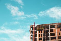 Construction site with builders who stand building stock photography