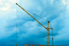 Construction site building crane on evening sky Stock Image