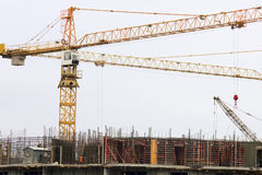 Construction site with building cranes Royalty Free Stock Images