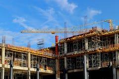 Crane construction bricks concrete building in city Royalty Free Stock Images
