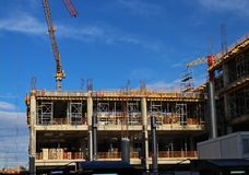 Crane construction bricks concrete building in city Royalty Free Stock Image
