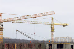 Construction site with building cranes and workers Stock Image