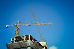 Construction site building industry with machinery crane. And engineering worker Stock Photo