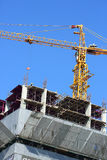 Construction site building industry with machinery crane. Working and laborer worker Stock Photos
