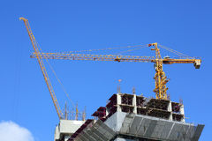 Construction site building industry with machinery crane working Royalty Free Stock Photography