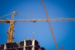 Construction site building industry with machinery crane Stock Photos