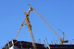 Construction site building industry with two machinery crane. Working Royalty Free Stock Image