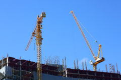 Construction site building industry with two machinery crane Royalty Free Stock Photo