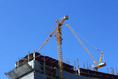 Construction site building industry with two machinery crane. Working Stock Photo