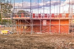 New Home Building. Construction site building a new brick home royalty free stock photography