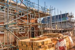 New Home Building. Construction site building a new brick home royalty free stock image