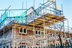 New Home Building. Construction site building a new brick home stock photo