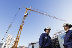 Construction site and building workers Stock Photo