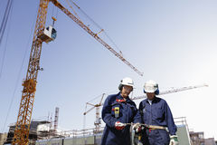 Construction site and building workers Stock Images