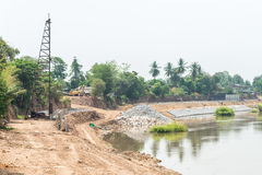 Construction site for built the protection dam. Royalty Free Stock Image