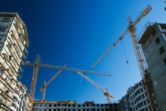 Construction site with bulding cranes Royalty Free Stock Photo