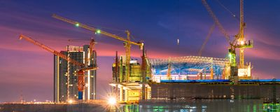 Construction site busy operate in beginning of building new complex infrastructure project. At twilight in panoramic banner cover size stock photo