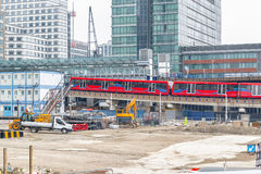 Construction site in Canary Wharf in London. With trains arriving station Stock Photos