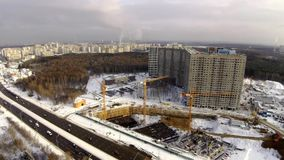 Construction site in the city. Aerial view at winter stock footage
