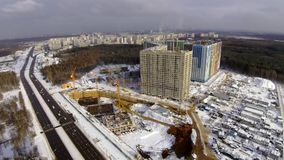 Construction site in the city. Aerial view at winter stock video