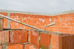 Construction site of clay bricks blocks home and tools Royalty Free Stock Photos