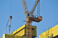 Construction site. Closeup yellow crane Stock Photo