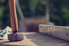 Construction Site concept with a wooden mallet and level Stock Image
