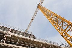 A construction site with concrete slabs built held together with scaffolding Stock Photo