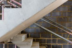 A construction site with concrete stairs and scaffolding Royalty Free Stock Photography