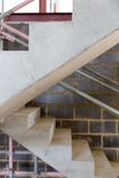 A construction site with concrete stairs and scaffolding Royalty Free Stock Photos