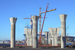 Construction site with concrete supports, and erected the tower Stock Photos