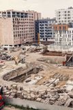 Construction Site, construction machinery, bulldozer, excavation. Factory,  cranes and sand. house building area in the city. brick walls and pit holes and Stock Photos