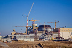 Construction site. Construction of a new nuclear power plant. Cranes are working. At building royalty free stock images