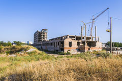 Construction site. Contemporary urban landscape. Construction site. Nice photo of unfinished building with blue sky in the background in a sunny day Stock Images