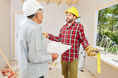 Construction site with craftsman and artisan Royalty Free Stock Image