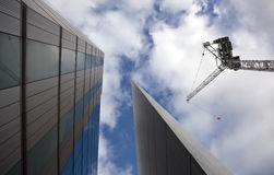 Construction site with crane. Over a blue and cloudy sky stock images