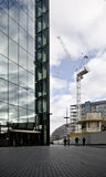 Construction Site crane. With modern glass building royalty free stock photos