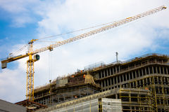 Construction site with crane. Photo of the construction site with crane, building and workers Royalty Free Stock Image