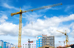 Construction site with crane. Against blue sky royalty free stock photos